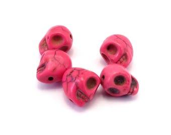 Set of 5 fuchsia howlite skulls