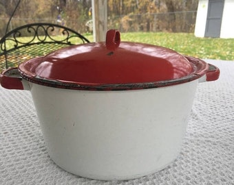 Red and white enamel pan with lid