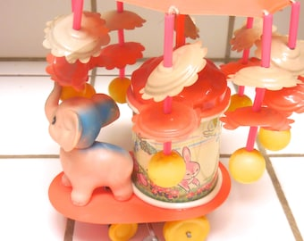 Wind Up Toy Carousel with Cellioud Elephant