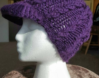 Purple cabled newsboy hat