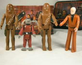 SALE  Four Star Wars Action Figures, 2 Chewbacca, Ben Kenobi, G.M.F.G.I. 1977, Snaggletooth G.M.F.G.I. 1978  WAS 36.00