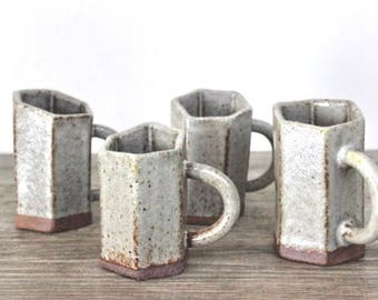 Extruded ceramic espresso cups. Speckled Gray, with a slanted hexagonal design