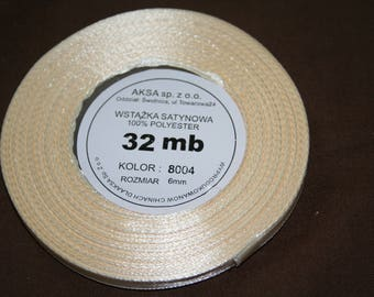 32 meters of 6 mm wide sold beige satin ribbon has coil