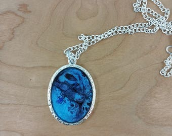 Necklace: shades of blue framed oval pendant on silvery chain; gift for her