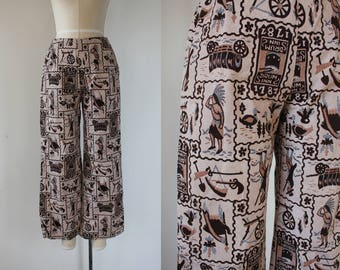vintage 1960s pants / 60s novelty print pants / 60s thanksgiving pants / 60s low rise pants / colonial pilgrim theme /wide leg pant / m 28w