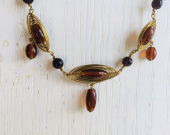 Brown necklace with brass wire and glass beads