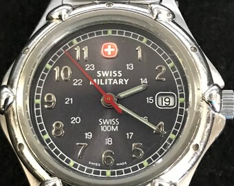 Sleek 2001 Swiss army wmns stainless quartz SMT watch