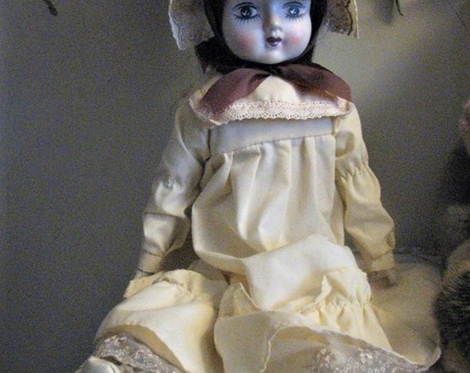 COLLECTABLE DOLL - girl, soft body, brown hair, 18 inches tall