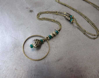"Necklace ""the perforated"" green colored agate."
