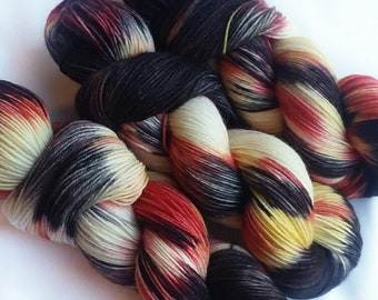 Hand dyed yarn, Wicked Fiah, 75/25 super wash merino wool/nylon sock yarn, black yarn, yellow yarn, red yarn