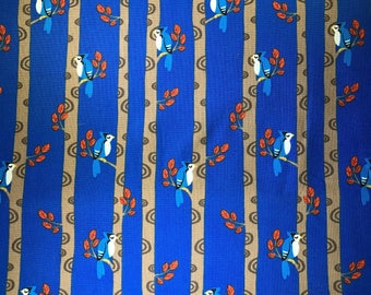 Fabric with blue birds on trees