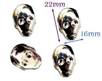 Set of 90 silver metal skull studs, 22x16mm