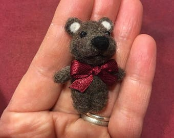 Handmade teddy bear made of carded wool.