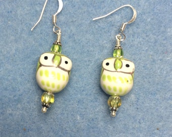 Olive green ceramic owl dangle earrings adorned with green Czech glass beads.
