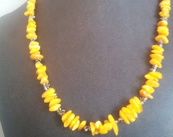Beautiful Baltic butterscotch amber long beaded necklace, with pewter dragonfly bead spacers.