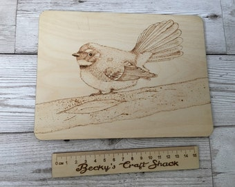 Wood burned fantail bird on roughly A5 wooden plaque. Pyrography wildlife and nature wood art