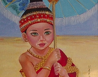 Little girl from Laos on her most beautiful, all in Traditional Costume