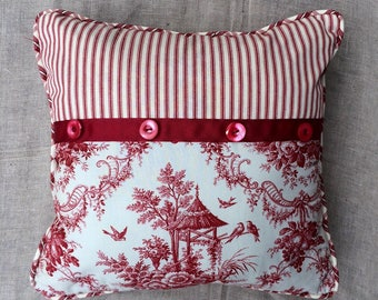 Cottage Chic Red Toile Decorative Pillow with Red ticking , Vintage buttons and Red Gros Grain Ribbon.