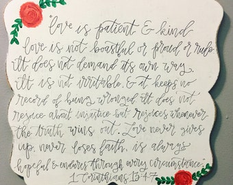 1 Corinthians 13 'love never fails' sign