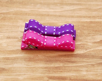 Toddler , baby , girls clippies fully lined on double prong alligator clips in purple and pink grosgrain with white stitch and tuxedo bows