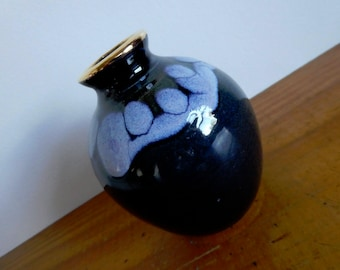 Small pottery vase drip glazed in blue with gold lip signed by maker