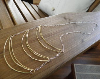 """Necklace... """"Sunlight"""" hammered brass wire suspended on a sterling silver chain."""