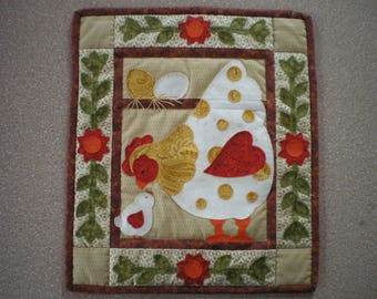 Chalkboard patchwork representing a hen and her chick