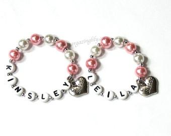 ONE Sister Charm Bracelet. YOU CHOOSE the color. Sister gift for big middle or little sister. Baby Kids Adult Sizes Heart Charm Bracelet