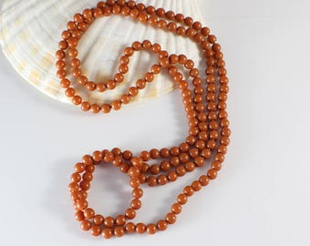1960s Long Small Round Smooth Popper Beads Brown Beaded Plastic Bead Necklace
