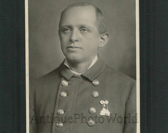 Firefighter in uniform with medal antique firefighting cabinet photo Reading PA