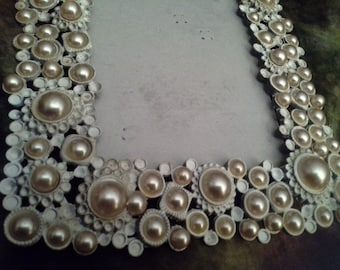 Its a frame up......faux vintage pearl look picture frame, with glass