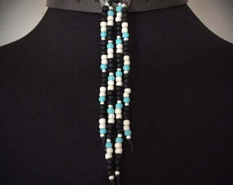Buffalo concho leather choker with seed and sterling silver beads