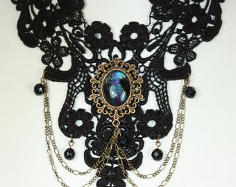 Black lace necklace with purple galaxy glass cabochon.