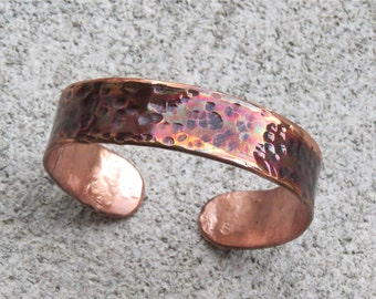 textured copper bracelet with patina