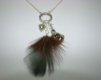 Necklace with feather, heart, flower