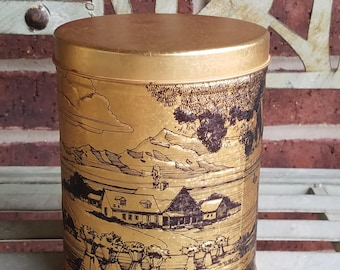 1977 Gold Tin Embossed with Farmhouse and Windmill Scene