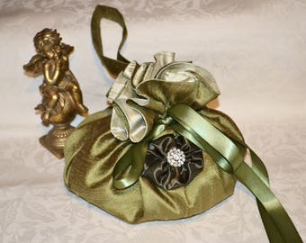 Pouch in khaki silk and the satin flower and rhinestone
