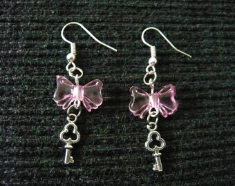 Pink bow earrings and key