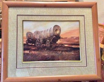 Vintage Ruane Manning 1983 print covered wagons sunset. Matted framed.