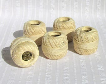 Five skeins of vintage Daisy brand, Mercerized Crochet cotton, ivory color, 250 yards, size 10, Lily Mills Co., Shelby, N.C., pre-1974.