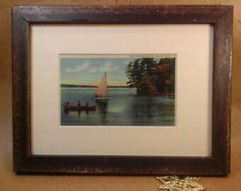 Framed Vintage tinted Linen Postcard, Sailboat & Canoe on Maine Lake