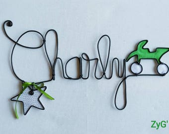 Plate holder or decorative wall personalized with child's name.