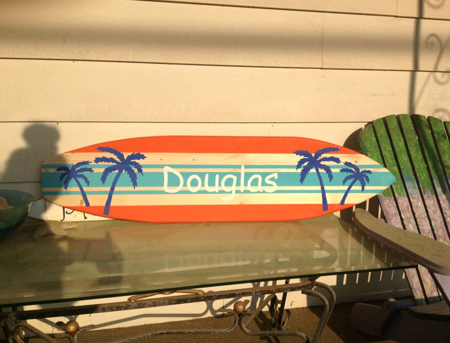 4 foot wood surfboard wall art with multiple stripes and palm