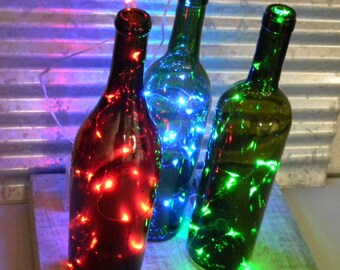 18 Red, Green, Blue, or Pink Fairy Lights (starry lights) on 3 or 6-ft silver or copper wire strands. Battery-operated lights with timer.