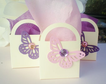 16 butterfly party favors, pink, purple cream tissue included
