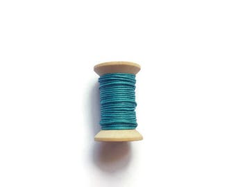 Peacock blue waxed cotton threads