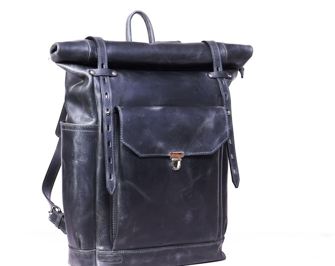 "Roll top leather backpack in grey colour.  Rucksack for 15"" laptop."