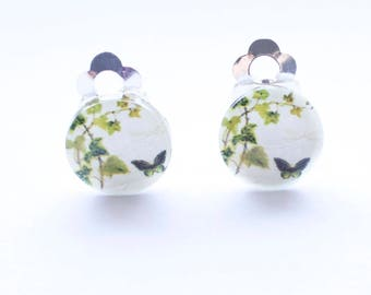 Green butterfly clip on earrings