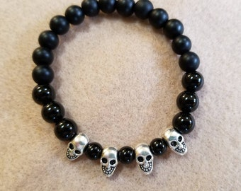 Black Onyx with metal skulls bracelet
