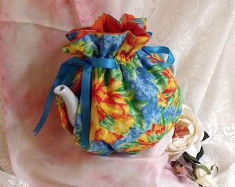 tea pot cosy or tea pot, colorful flowers, fresh colors and tonic.